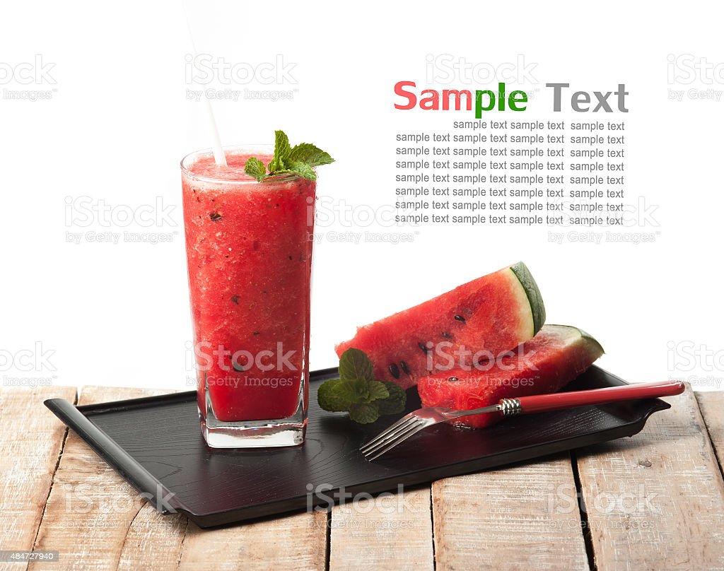 glass of fresh watermelon juice on wood stock photo