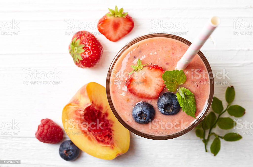 Glass of fruit and berry smoothie stock photo