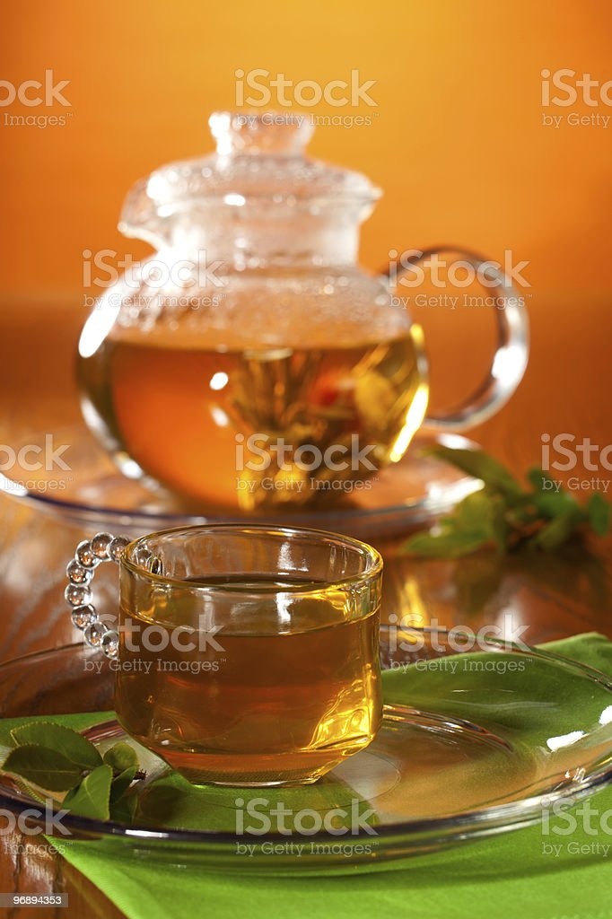 Glass of greean tea and teapot royalty-free stock photo