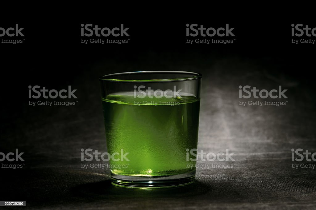 Glass of green drink stock photo