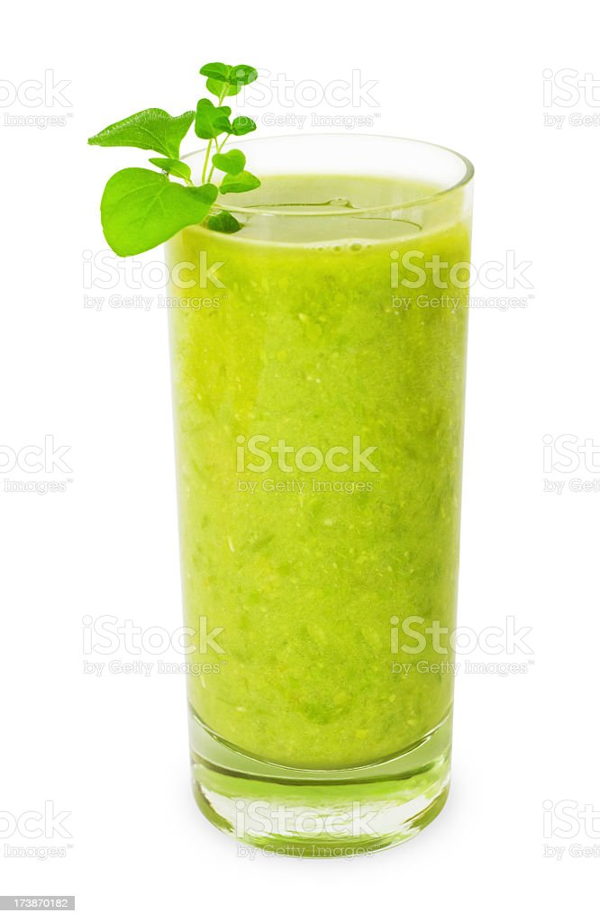 Glass of green smoothie isolated on white stock photo