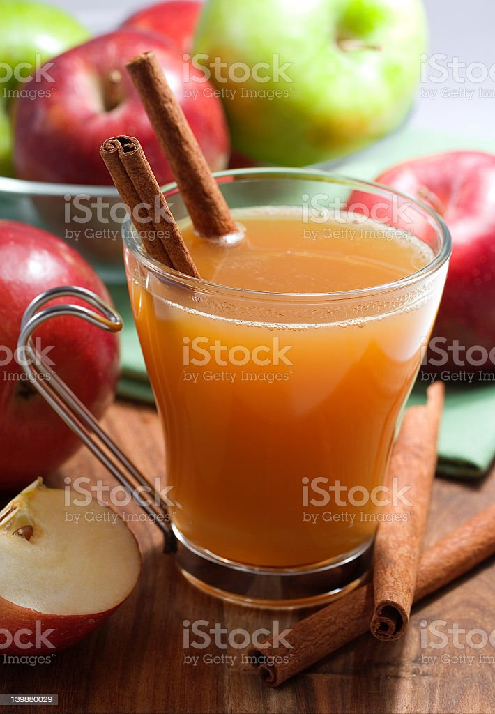 A glass of home made apple cider stock photo