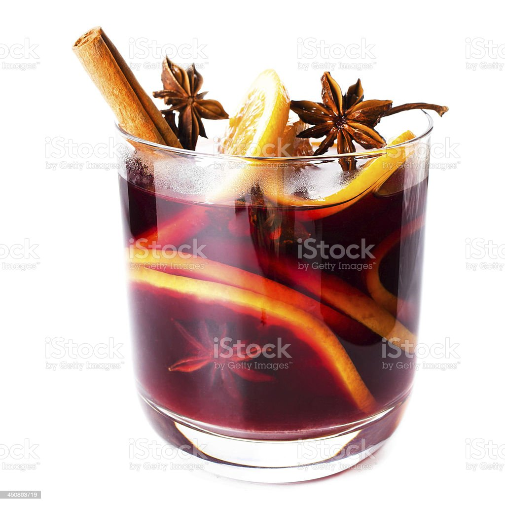 A glass of hot red mulled wine with citrus slices and spice stock photo
