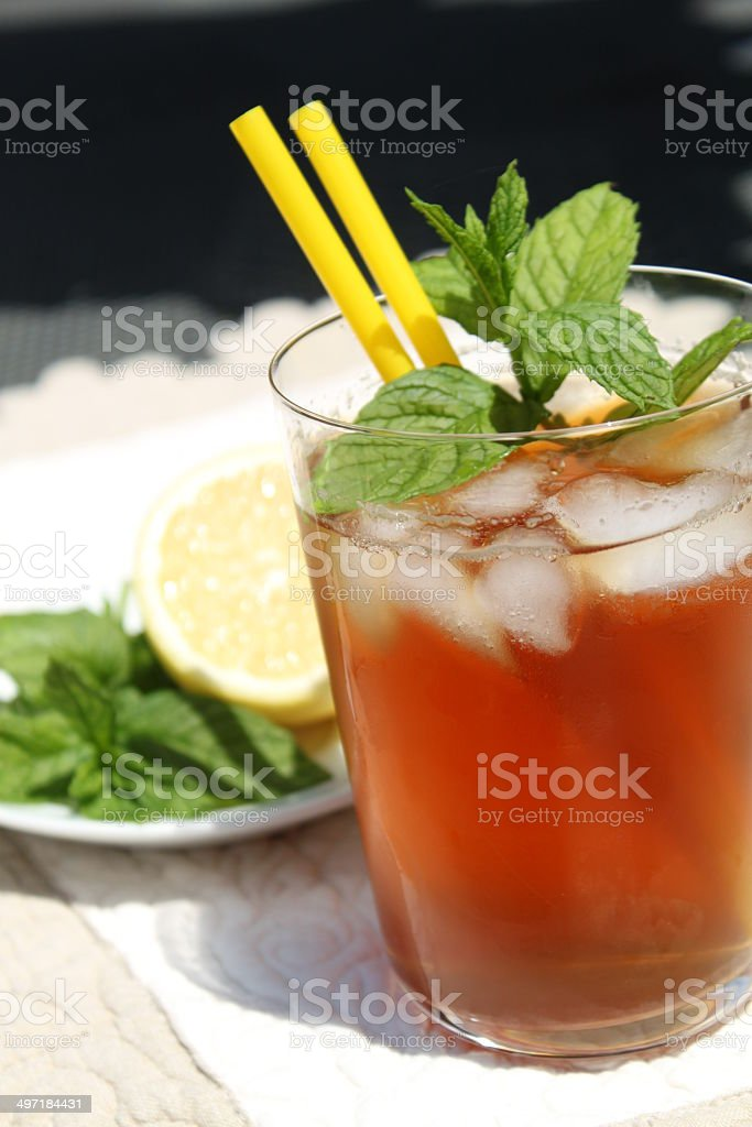 Glass of iced tea with mint leaves and lemon royalty-free stock photo