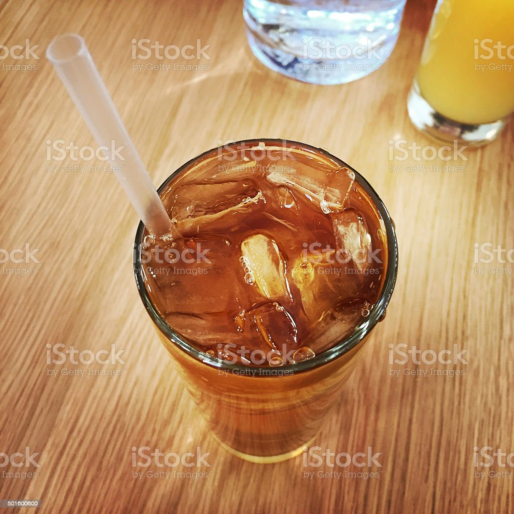 Glass of Iced Tea with Straw stock photo