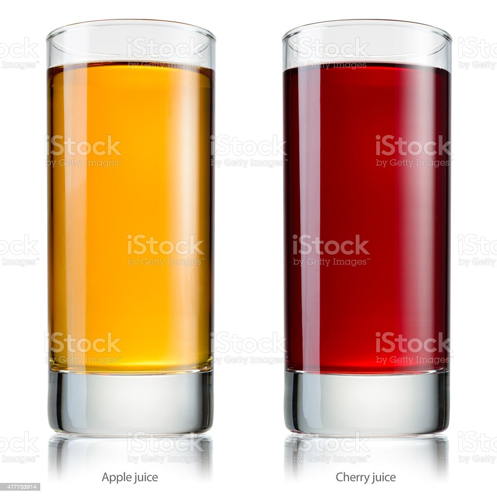 Glass of juice. Apple and cherry. With clipping path. stock photo