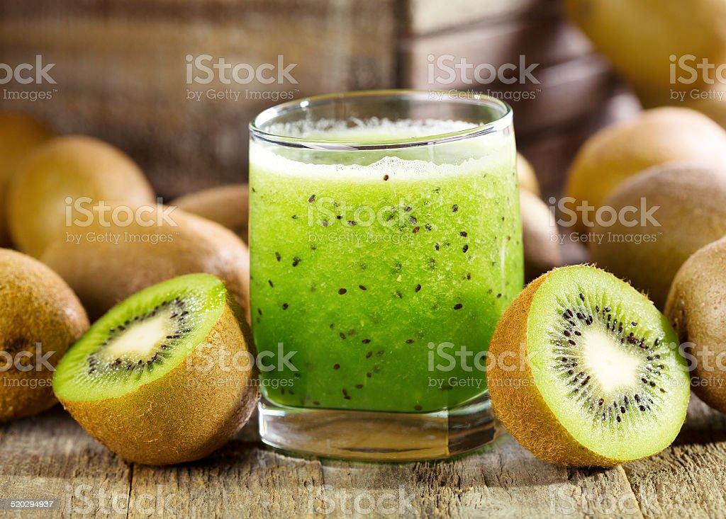glass of kiwi juice with fresh fruits stock photo