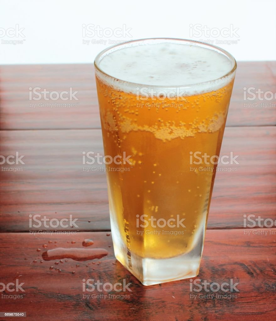 A glass of Lager beer stands on the table flip-top bottle stock photo