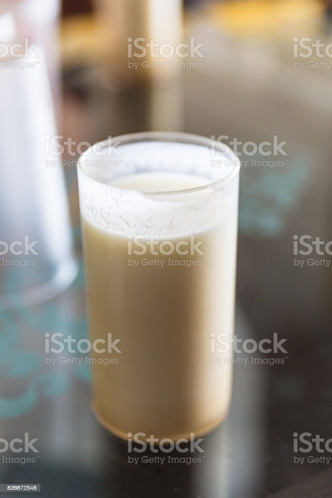 A glass of lassi, is a popular traditional yogurt-based drink from the Indian Subcontinent. Served in the restaurant at Gangtok. Sikkim, India. stock photo