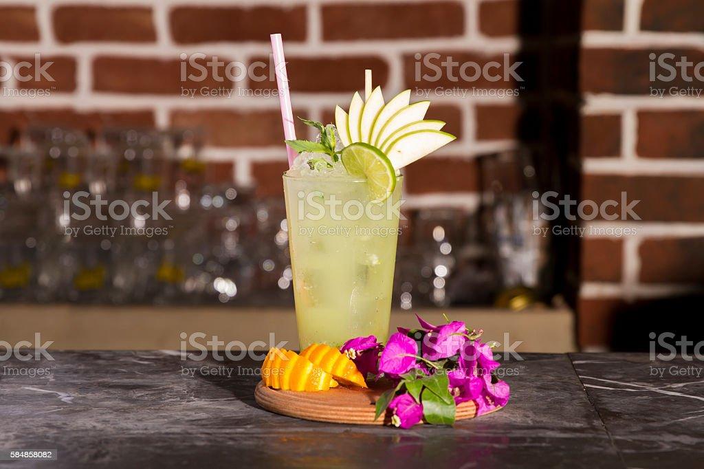 Glass of lemonade mojito cocktail in bar stock photo