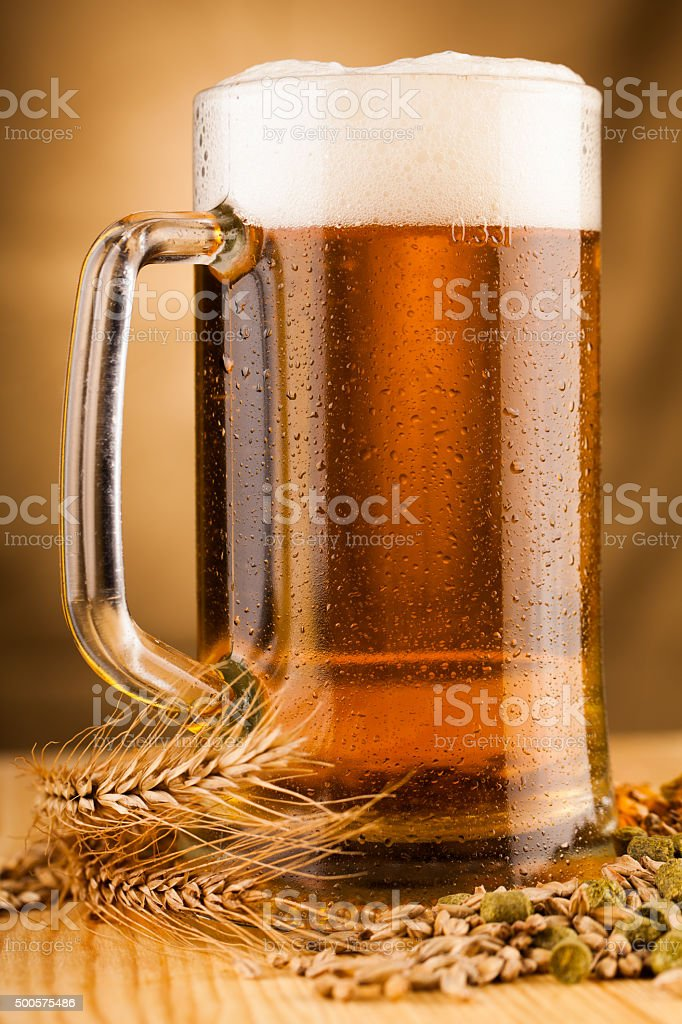 Glass of light beer on table stock photo