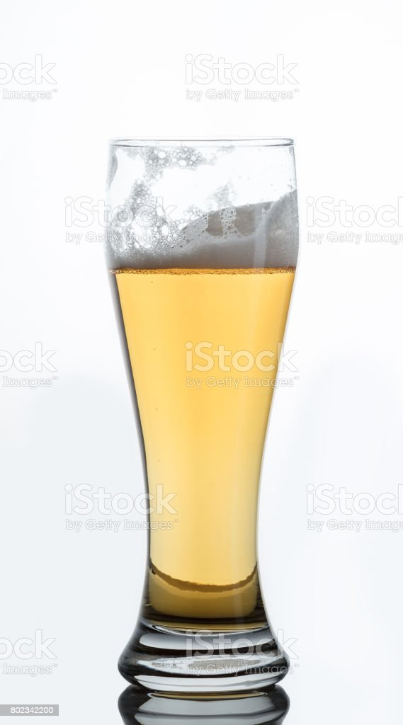 Glass of light beer stock photo