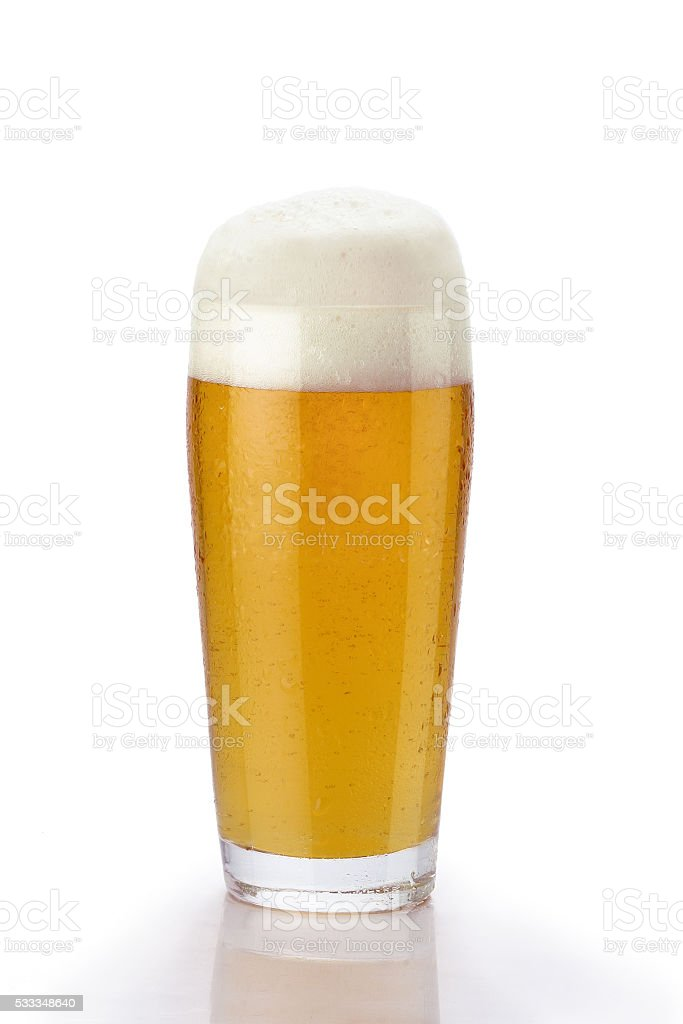 Glass of light beer with froth over white background stock photo