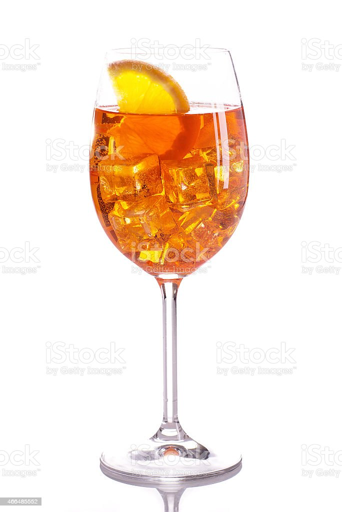 Glass of light orange mixed drink stock photo