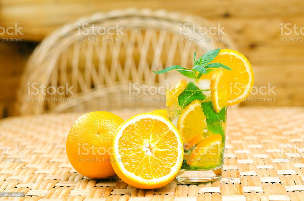 glass of limonade with oranges royalty-free stock photo