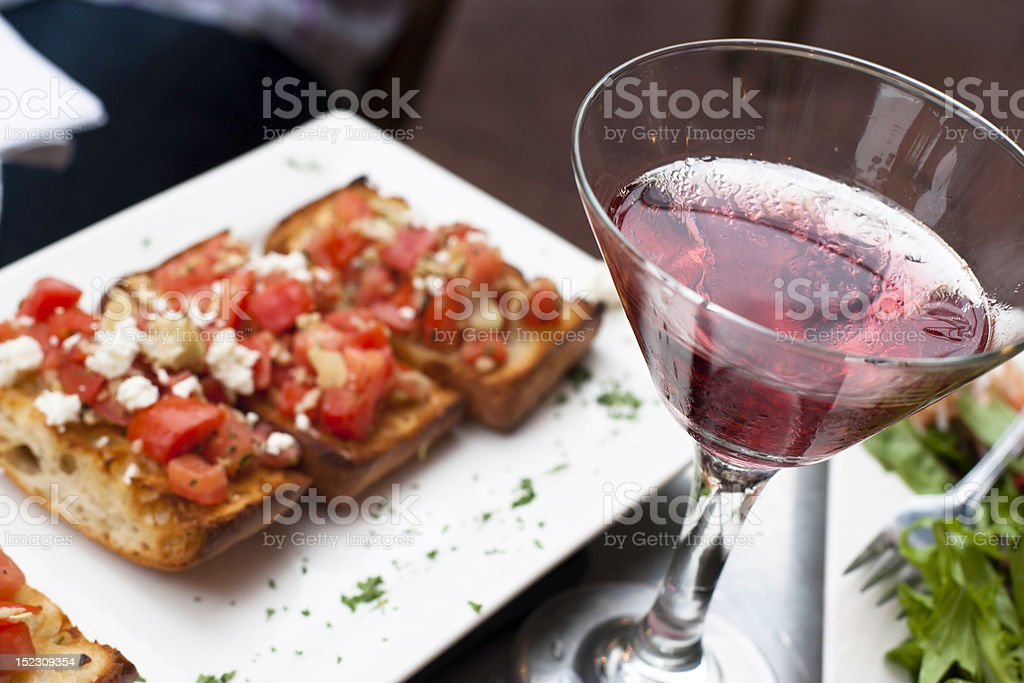 Glass of martini and a plate of snacks stock photo