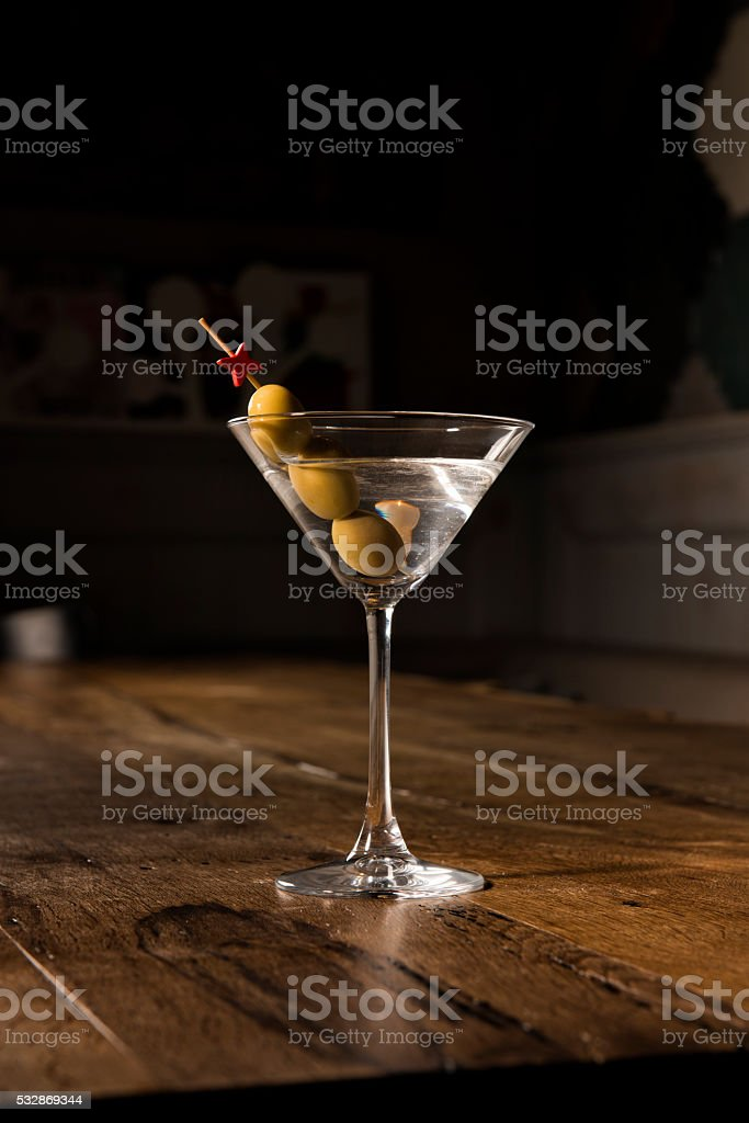 glass of martini on a restaurant table stock photo