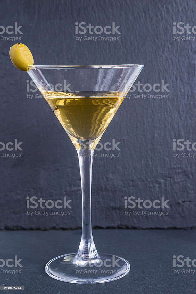 Glass of Martini with olive stock photo