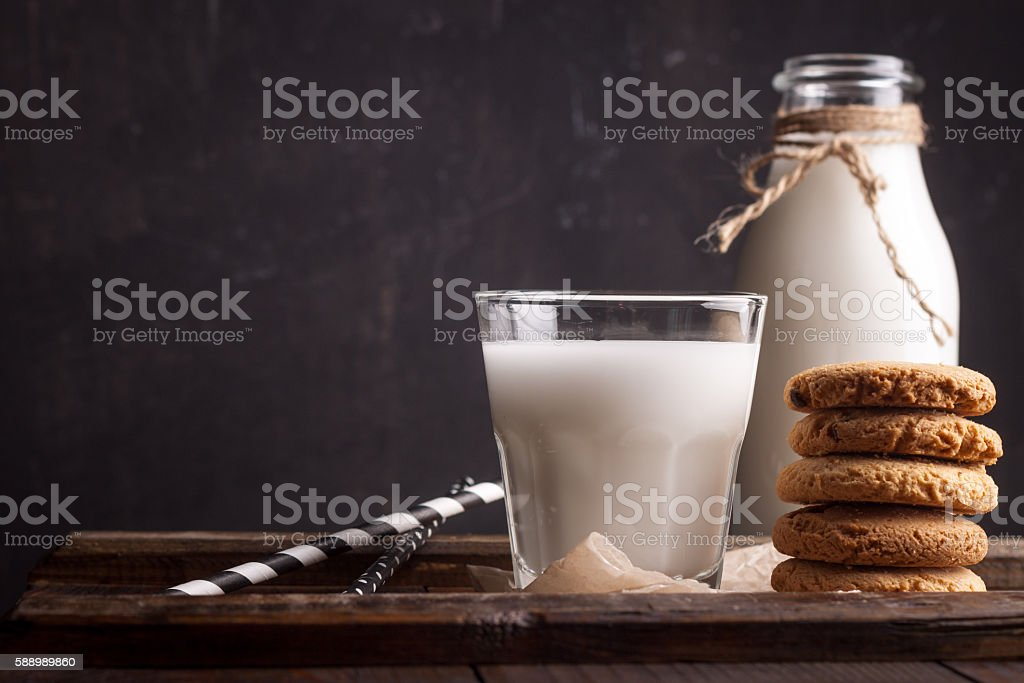 Glass of milk and chocolate chip cookies stock photo