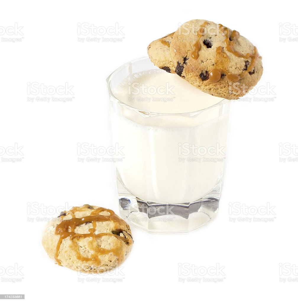 Glass of milk and oatmeal cookies with caramel royalty-free stock photo