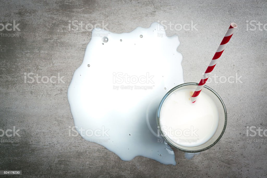 Glass of milk on a concrete table stock photo