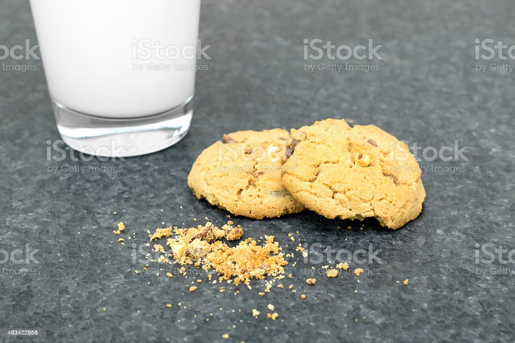 glass of milk on a table and cookies stock photo