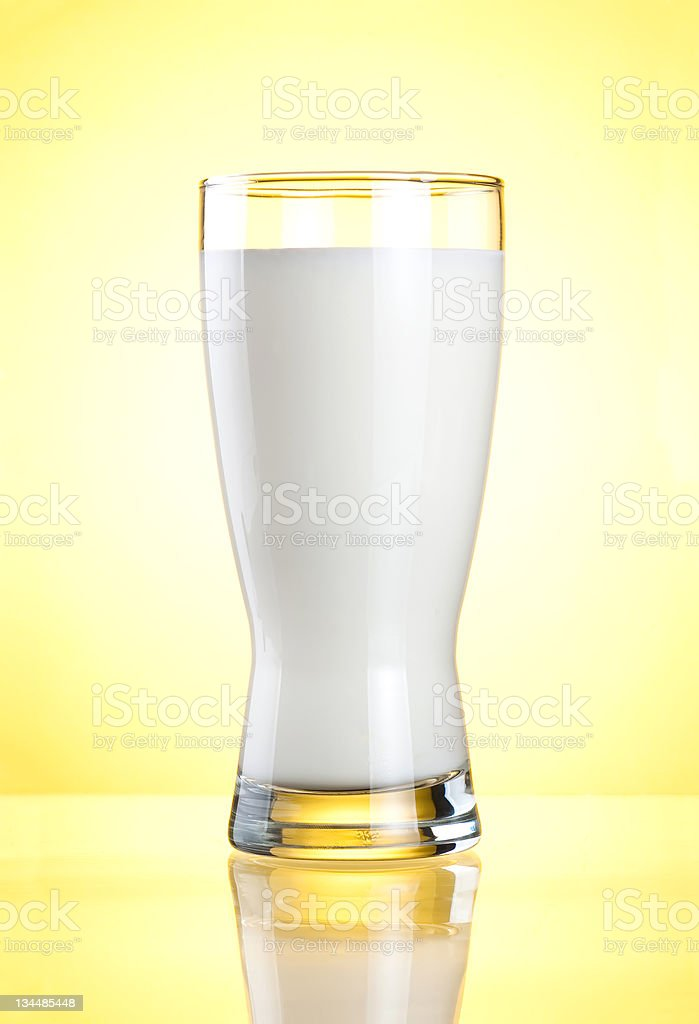 Glass of milk on yellow background royalty-free stock photo
