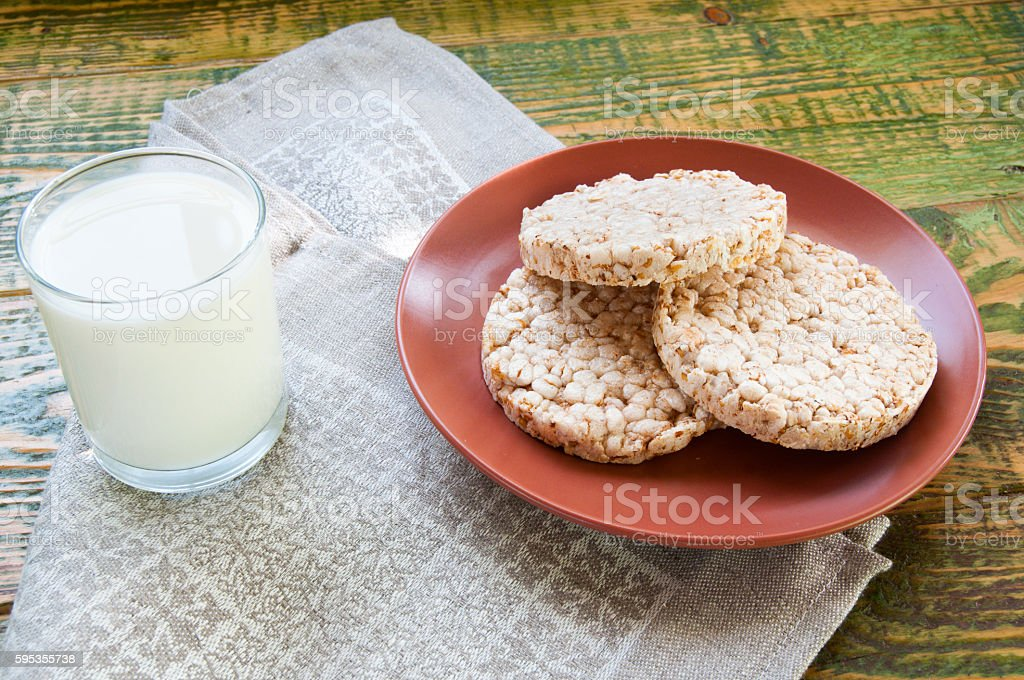 Glass of milk with Crispbread on clay plate stock photo