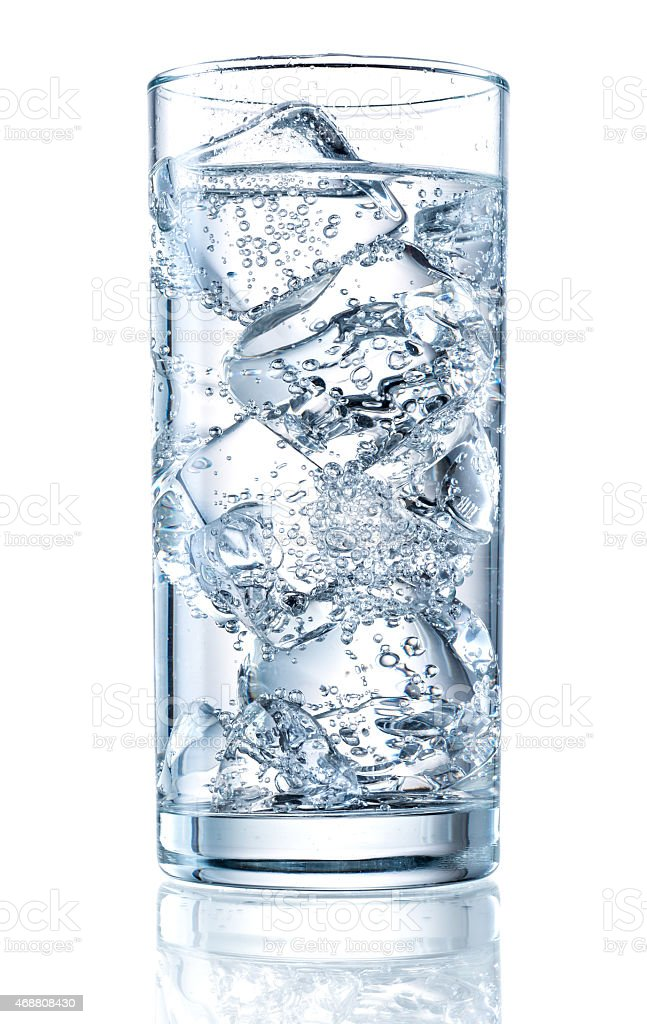 Glass of mineral carbonated water with ice stock photo