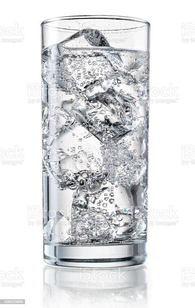 Glass of mineral water with ice. With clipping path stock photo