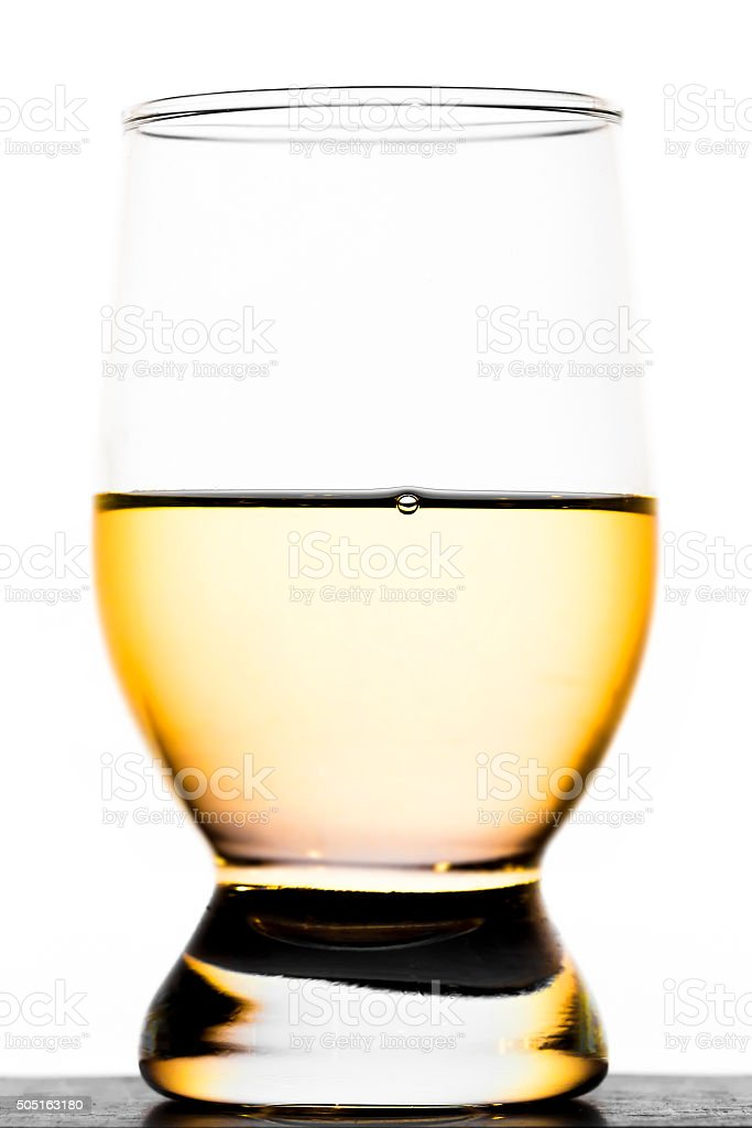 Glass of moonshine stock photo