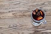 Glass of mulled wine on the wooden background