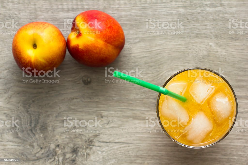 Glass of nectarine peach juice. Directly above view. stock photo