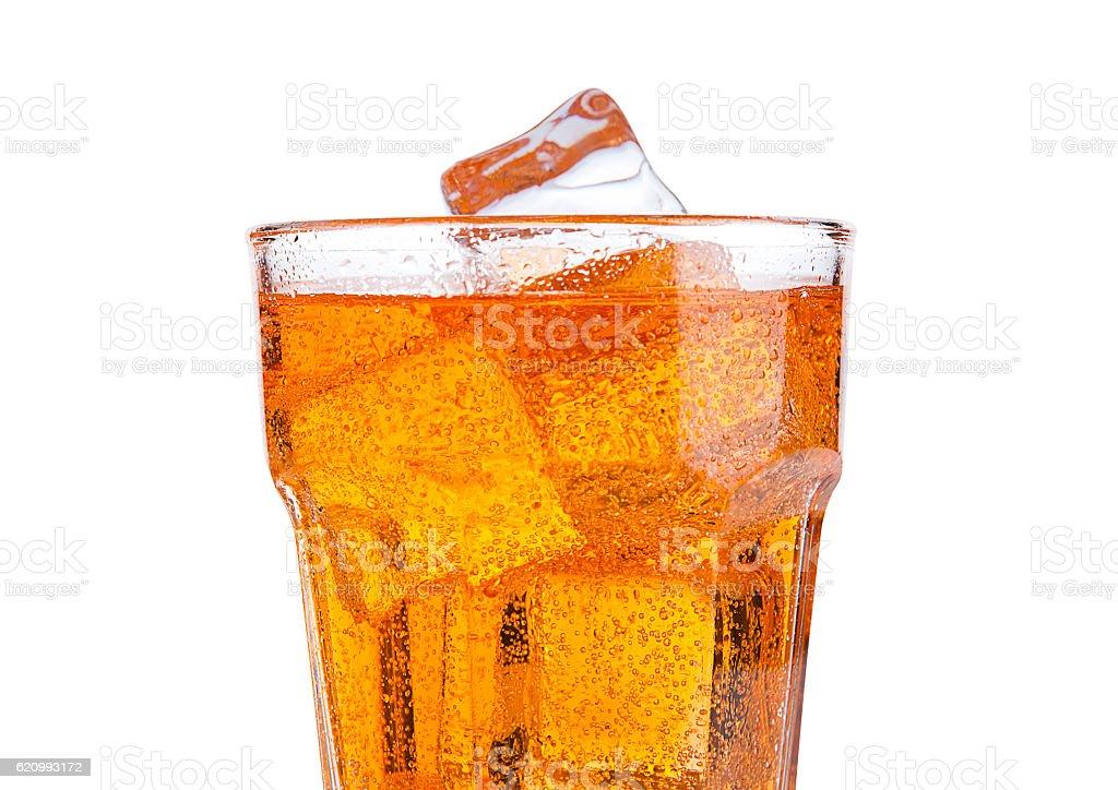 Glass of orange energy soda drink with ice stock photo
