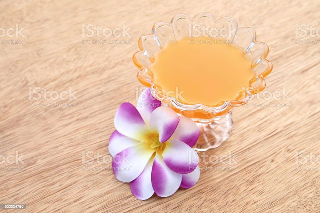 glass of orange juice on wooden background stock photo
