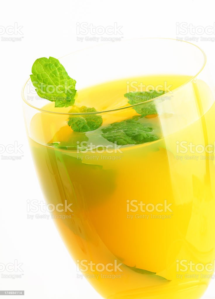 glass of orange juice with ice and mint royalty-free stock photo