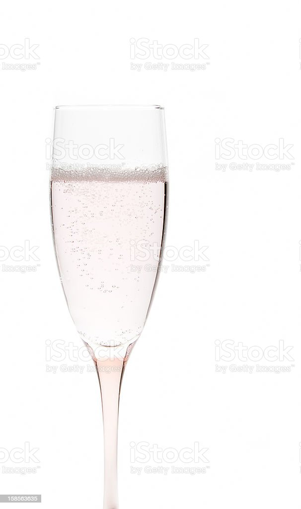 Glass of pale pink champagne stock photo