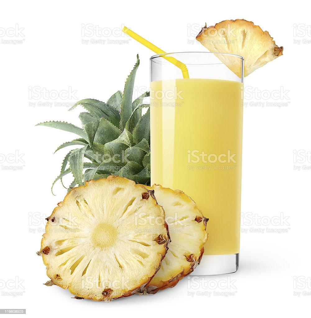 Glass of pineapple juice decorated with pineapple slice royalty-free stock photo