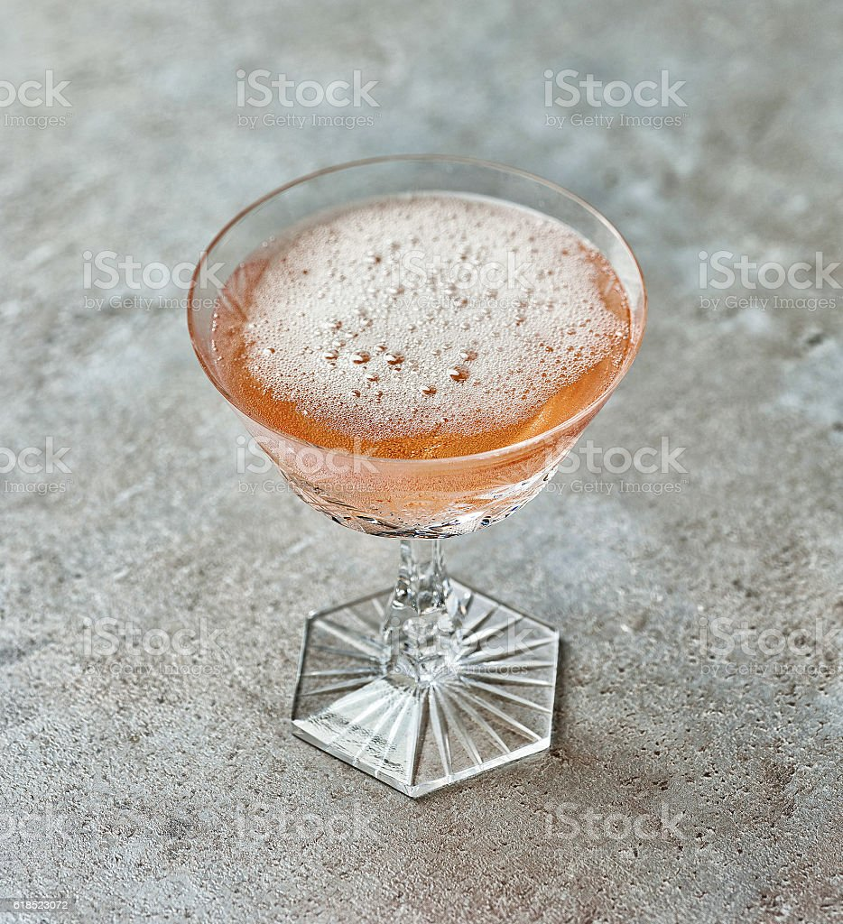 glass of pink champagne stock photo