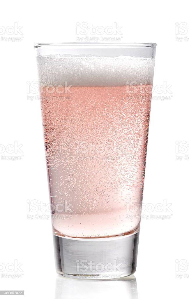 Glass of pink cider stock photo
