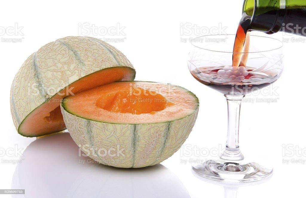 Glass of porto wine with a melon cut in half stock photo