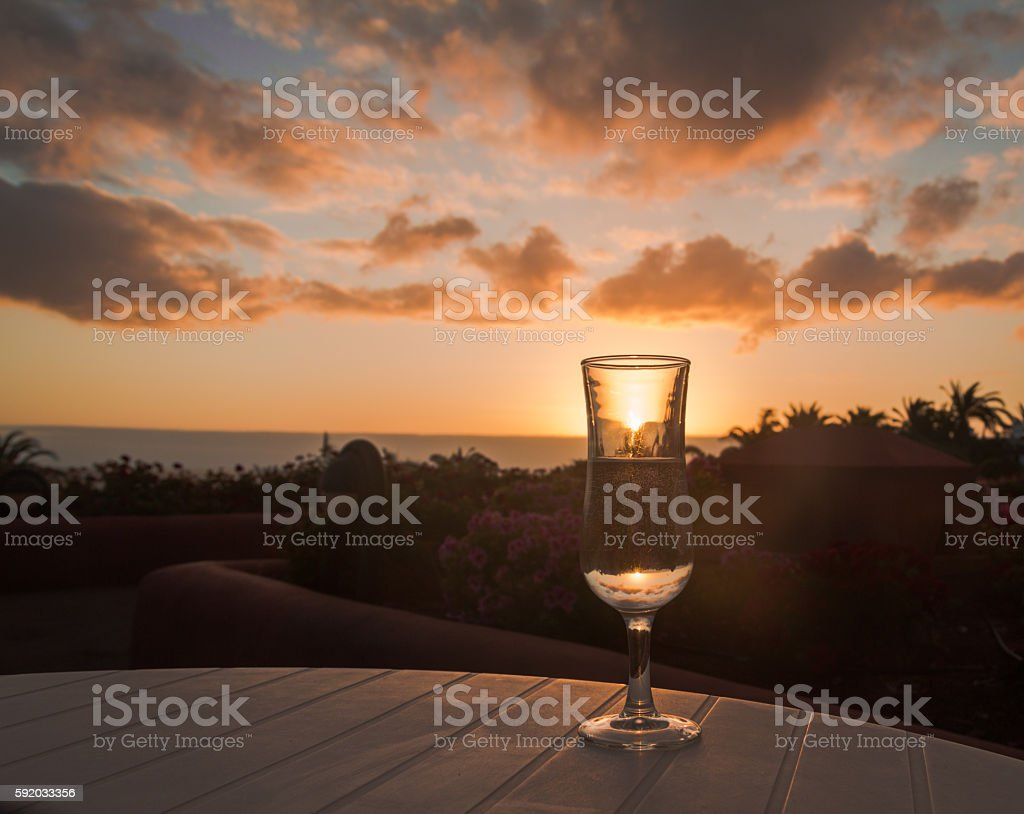 Glass of pure water and sunset stock photo