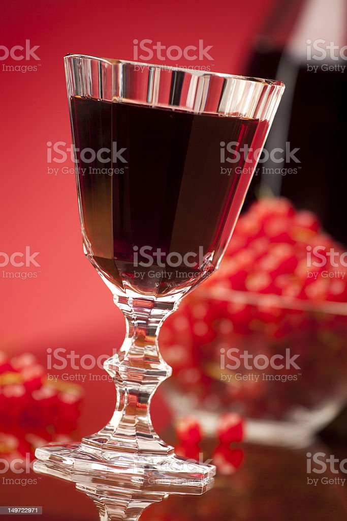glass of red fruit wine stock photo