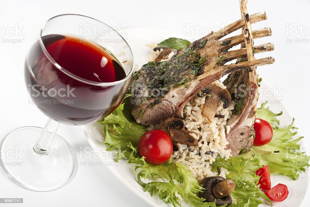 glass of red wine and barbecue ribs on a plate royalty-free stock photo
