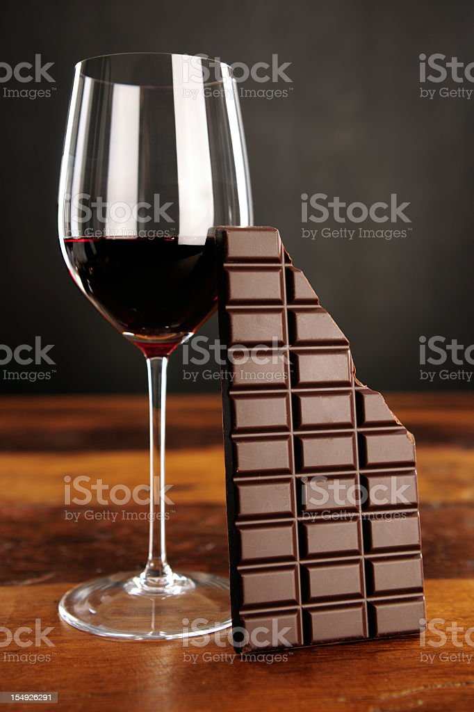 Glass of red wine and chocolate bar stock photo