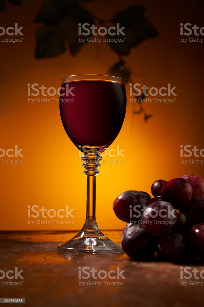glass of red wine and grapes stock photo