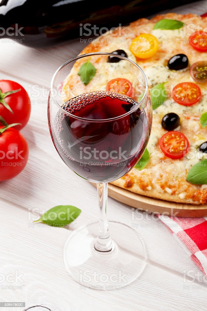 Glass of red wine and italian pizza stock photo
