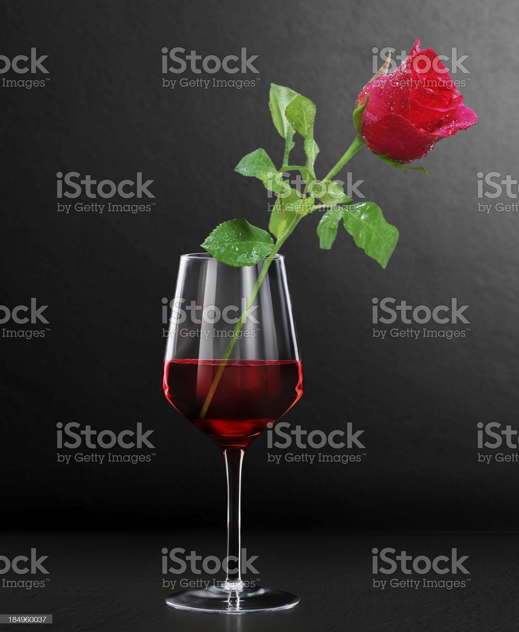 Glass of red wine and roses royalty-free stock photo