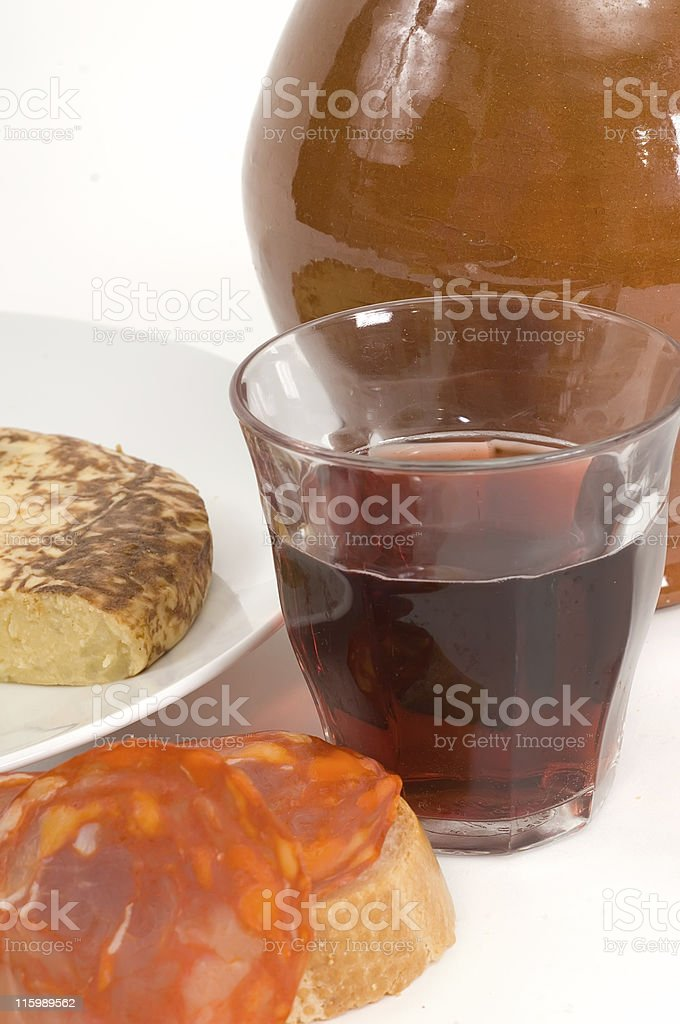 Glass of red wine and spanish tapas stock photo