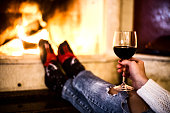 Glass of red wine by the fire place